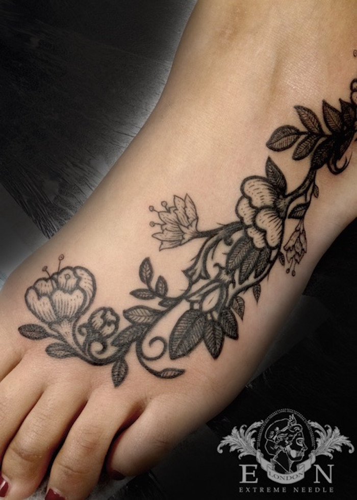 Flowers on feet dotwork tattoo