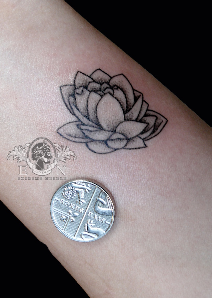 Lotus mini tattoo